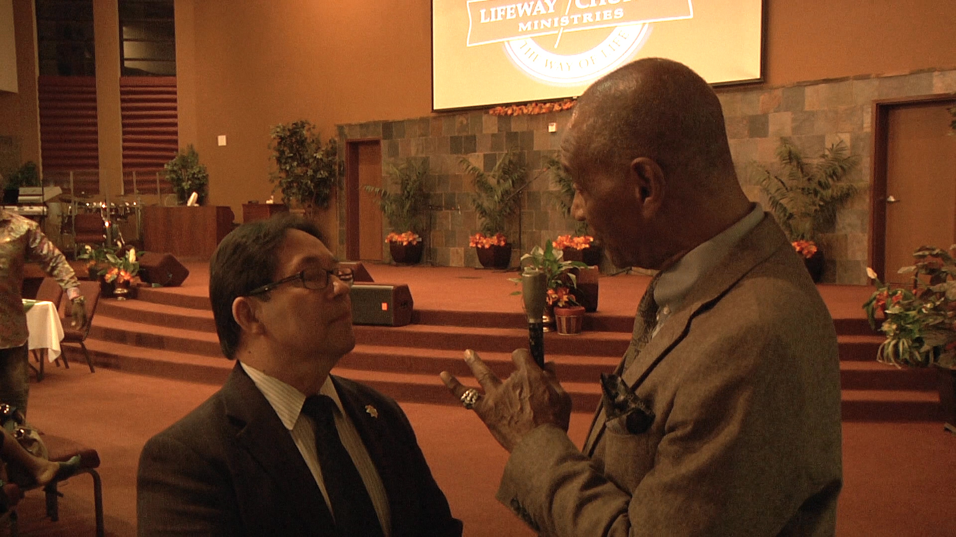 wallace-interviewing-normannunez-at-empowerment-event
